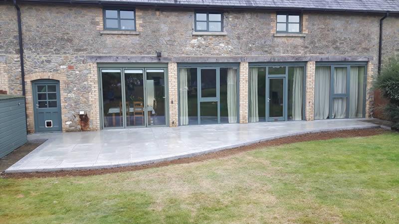 Granite light edging with porcelain paving, Devon