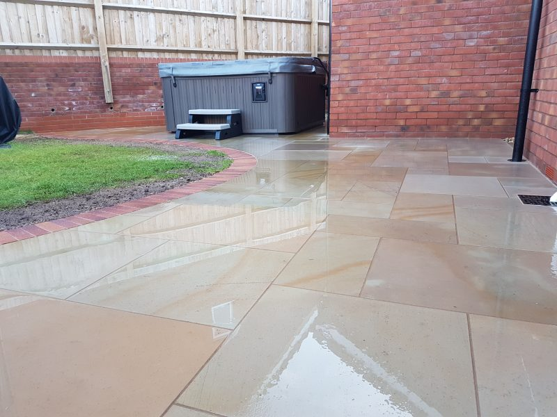 Versuro golden sand paving with brick edgings and hot tub, Kingsteignton, Devon