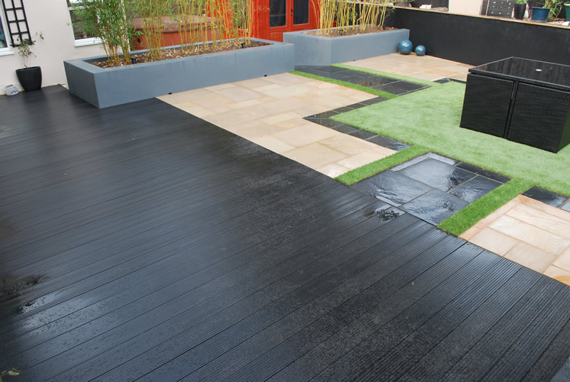 Black composite decking with fake grass